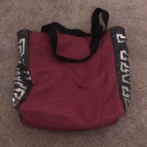 pink duffel bag and small case bag